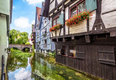 Street with vintage half-timbered houses in old town of Ulm, Germany. Medieval Fish Quarter is tourist attraction of Ulm. View of ancient Fisherman`s district of Ulm city and canal in summer.