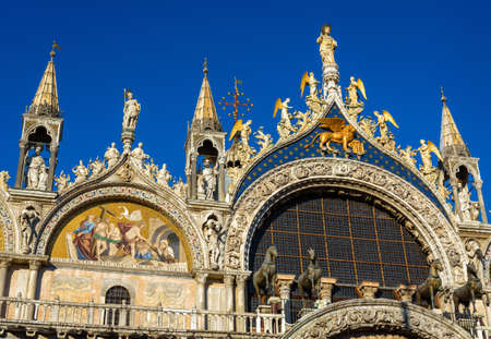 St Mark`s Basilica or San Marco close-up, Venice, Italy. It is top landmark in Venice. Beautiful ornate exterior of medieval basilica, detail of luxury facade of famous Saint Mark`s cathedral. Stock fotó
