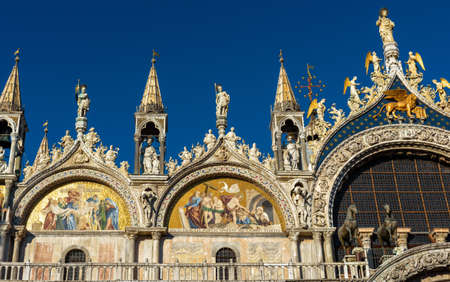 San Marco or St Mark`s Basilica closeup, Venice, Italy. It is top landmark in Venice. Beautiful cathedral exterior, detail of ornate facade of famous Saint Mark`s church, monument of medieval culture.
