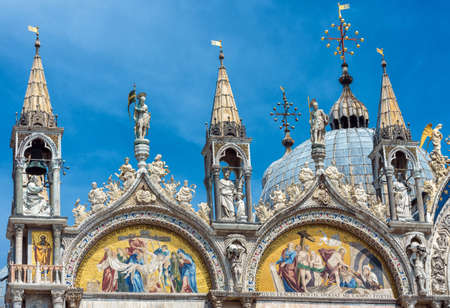 St Mark`s Basilica or San Marco close-up, Venice, Italy. It is top landmark in Venice. Beautiful Christian mosaic of basilica exterior, detail of ornate facade of old famous Saint Mark`s cathedral.
