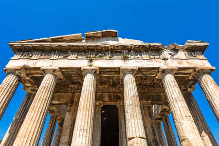 Temple of Hephaestus in Ancient Agora, Athens, Greece. It is famous landmarks of Athens. Front view of classical Greek temple on sky background, monument of old Athenian culture. History concept.