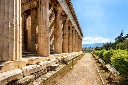 Temple of Hephaestus in Ancient Agora on sunny day, Athens, Greece. House of Hephaestus is famous landmark of Athens. Perspective view of classical Greek building in Athens city center in summer.
