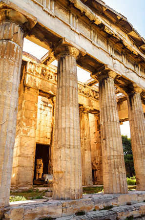 Temple of Hephaestus in Ancient Agora on sunny day, Athens, Greece. It is famous landmarks of Athens. Close view of classical Greek building in sunlight. Concept of old Athenian culture and history.