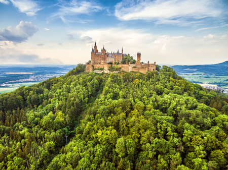 Hohenzollern Castle on mountain top, Germany. This fairytale castle is famous landmark in Stuttgart vicinity. Aerial view of Burg Hohenzollern in summer. Landscape of Swabian Alps with Gothic castle. Editorial