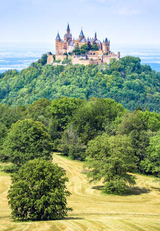Hohenzollern Castle on mountain top, Germany. This fairytale castle is famous landmark in Stuttgart vicinity. Scenic view of Burg Hohenzollern in summer. Landscape of Swabian Alps with Gothic castle. Editorial