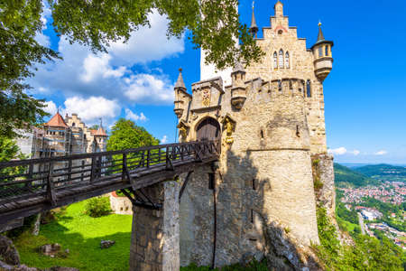 Lichtenstein Castle with bridge, Baden-Wurttemberg, Germany. This fairy tale castle is a landmark of Germany. Front view of Lichtenstein Castle on a cliff. Tourist place in Swabian Alps in summer.