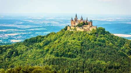 Hohenzollern Castle on mountain top, Germany. This castle is a famous landmark in vicinity of Stuttgart. Scenic panorama of Burg Hohenzollern in summer. Landscape of Swabian Alps with Gothic castle. Editorial