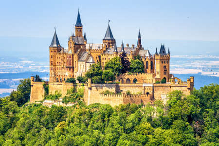 Hohenzollern Castle close-up, Germany. This fairytale castle is famous landmark near Stuttgart. Scenic view of mount Burg Hohenzollern in forest. Scenery of Swabian Alps with Gothic castle in summer. Editorial