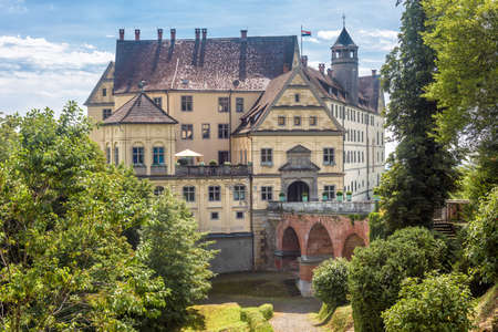Castle of Heiligenberg in Linzgau, Germany. This Renaissance castle is a landmark of Baden-Wurttemberg. Front view of old castle in garden. Scenery of medieval German castle with bridge in summer.