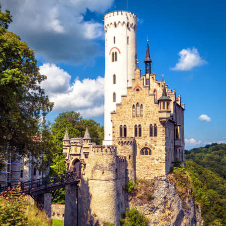 Lichtenstein Castle in summer, Baden-Wurttemberg, Germany. This famous castle is a landmark of Germany. Scenic view of fairytale Lichtenstein Castle on a rock. Nice mountain place in Swabian Alps.