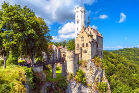 Lichtenstein Castle with high bridge, Germany. This scenic castle is a landmark of Germany. Beautiful view of fairytale Lichtenstein Castle on a cliff. Nice landscape of Swabian Alps in summer. Editorial