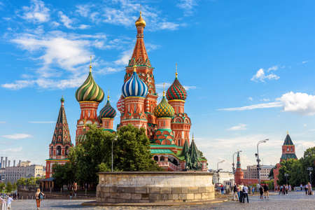 Moscow - July 20, 2020: St Basil`s cathedral on Red Square in Moscow, Russia. Ancient Saint Basil`s temple is a famous tourist attraction of Moscow. People walk next to landmark in old central Moscow.