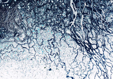 Earth from space, delta of Lena River, Siberia, Russia. Aerial view of winter landscape, abstract texture background. Pattern of frozen terrain on satellite photo. Beautiful relief surface in nature. Imagens