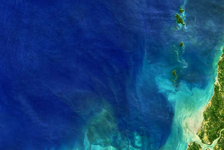 Sea taken from space, detailed Earth surface on global satellite photo. Aerial top view of blue ocean, tropical coastal waters for nature texture background. Standard-Bild