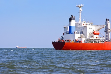 Convoy. A feed of the red cargo ship. photo