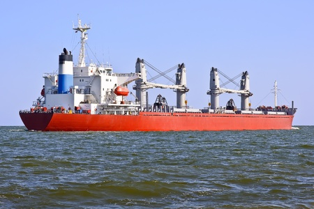 Red cargo ship in the sea. photo