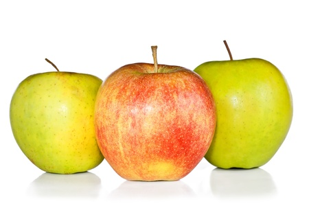 Two ripe green apples and one red apple are isolated on the white. photo
