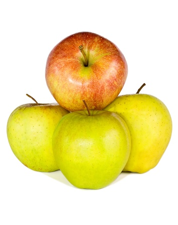 Tree green apples and one red apple are isolated on the white. photo