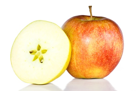 Fresh red apple and a halved of a green apple. photo