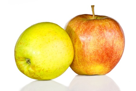 Green and red apples are isolated on the white. photo