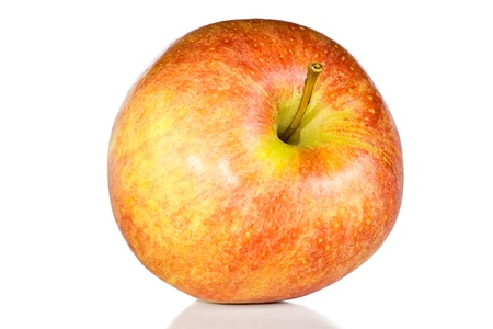 Fresh red apple is isolated on the white. photo