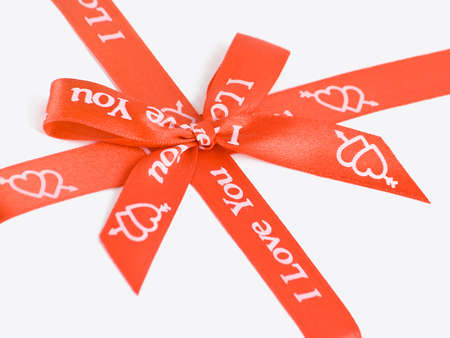 Red gift bow with hearts. Stock Photo - 9810299
