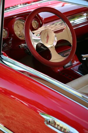 Red Leather Steering Wheel on Classic Sports Car Stock Photo - 1336097