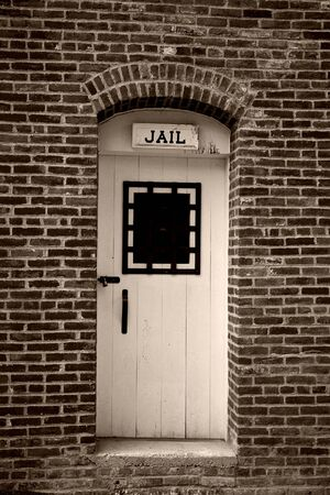 jail: Old West Jail Door Cell on Brick Building