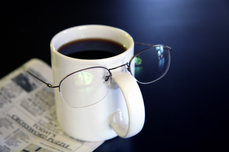 humor: Coffee Humor - Cup Filled with Coffee Beans Wearing Glasses