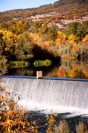 Gold Ray Dam Oregon Reflecting Fall Colors in Still Water photo