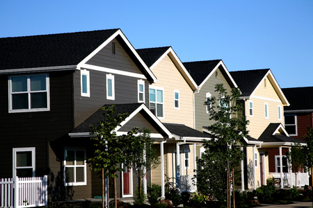 Row of Multi-colored Townhouses Stock Photo