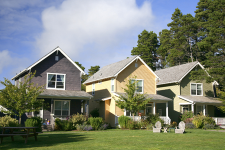 Row of Multi-Colored Two-Story Houses Stock Photo