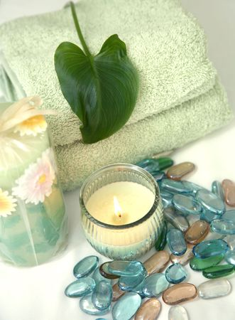 Spa Retreat with Towels, Candles, and Healing Stones