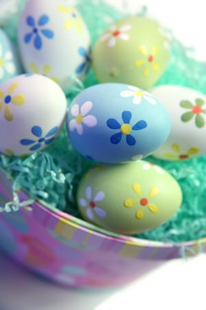 Colorful Easter Eggs in Grass with Basket