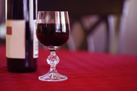 Heart Healthy Glass of Red Wine and Wine Bottle on Table Stock Photo - 2150669