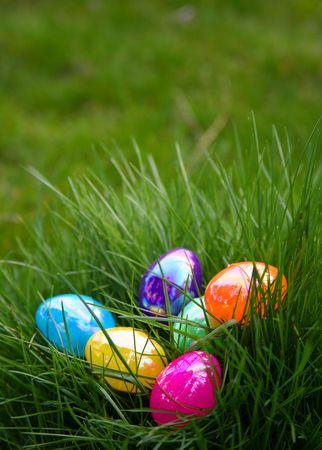 Plastic Colorful Easter Eggs in Grass Stock Photo