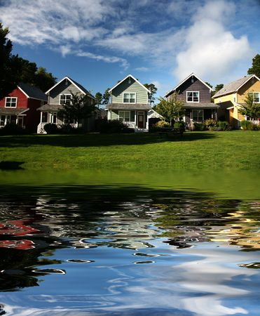 rentals: Row of Multi-Colored Houses Reflecting in Lake Water