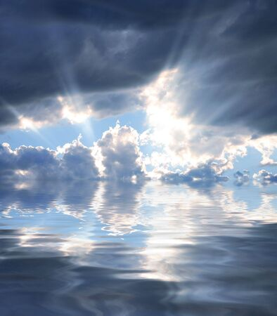 beaming: Rays of Sunshine Beaming through the Clouds Reflecting in Water Stock Photo