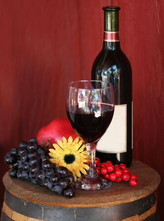 Red Wine with Fruit, Wine Bottle and Glass of Wine  Stock Photo