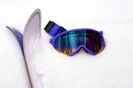 Hot Pink Ski Goggles and Skis in Snow photo