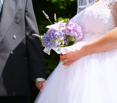 Bride and Groom with the Bridal Bouquet photo