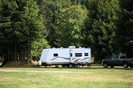 Camping with RV Trailer in the Redwood Forest Stock Photo