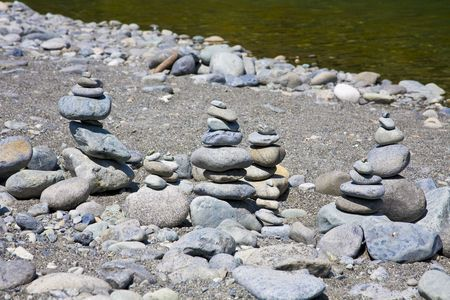 Rocks stacked and balancing in piles by river