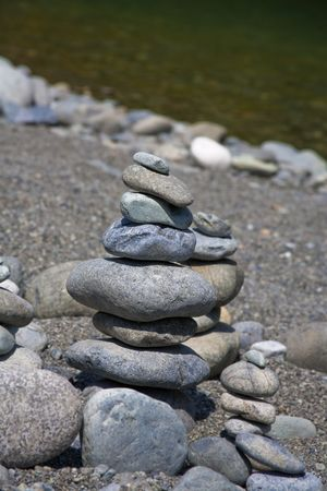 Rocks stacked and balancing in a pile by river