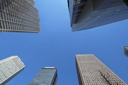 low angles: Sunny cloudless Shinjuku of building County Stock Photo