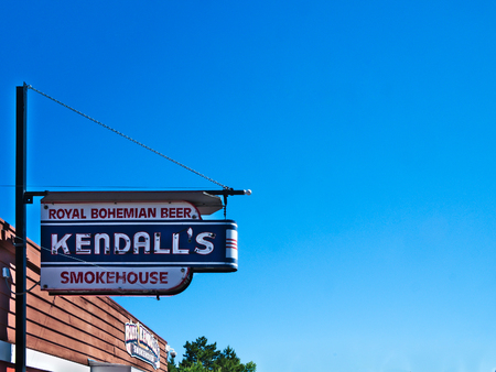Knife River, MN - July 2, 2018: Sign for Kendalls Smokehouse with blue sky background