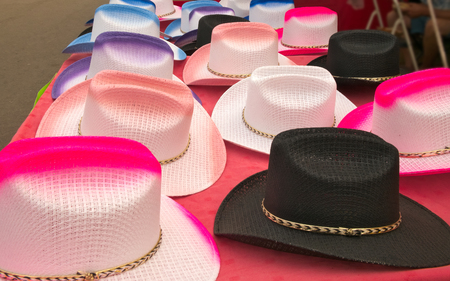 Colorful cowboy hats on display and for sale at a county fair