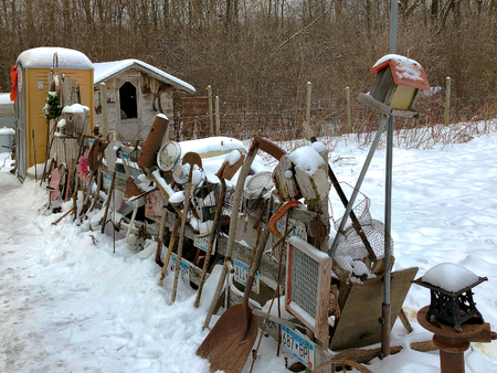 Old rusty broken junk for sale on display in snowy northern Minnesota in December.