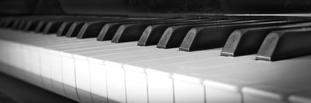Piano keys close up with black and white keyboard and shallow depth of field.