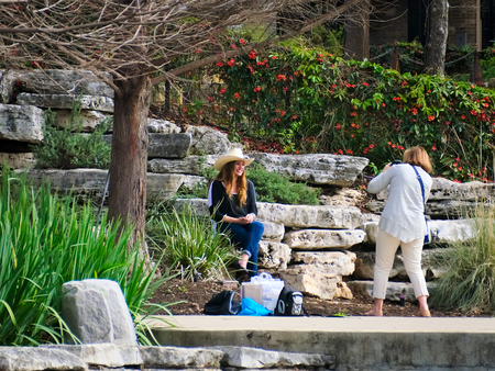 San Antonio, Texas - March 6, 2017: Outdoors photo shoot along the River Walk at the historic Pearl District of San Antonio, Texas.